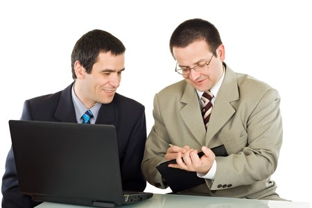 Two happy businessmen prepare a business plan - isolated Stock Photo