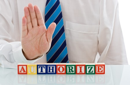 Businessmans palm above of authorize word, limited entering zone