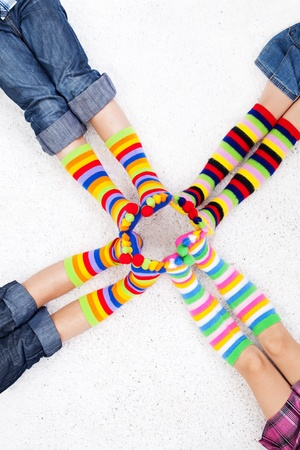 Legs with long colorful socks photo