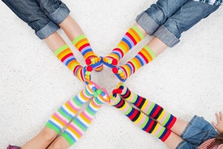 long socks: Legs with long colorful socks Stock Photo