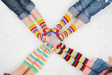 girl socks: Legs with long colorful socks Stock Photo