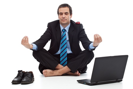 Young businessman meditating - stress control concept photo