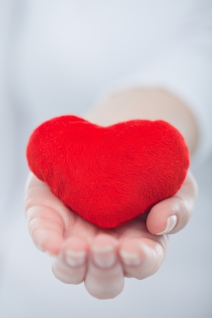 Red heart in the womans hand Stock Photo