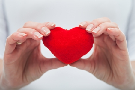 Woman hands holding red heart