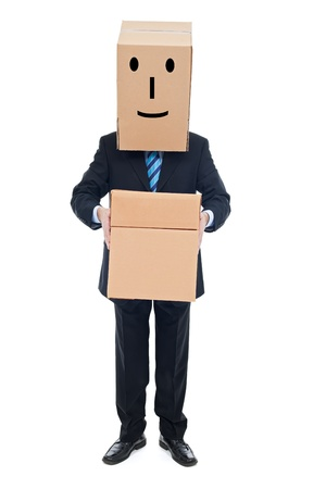 Successful happy businessman carrying cardboxes