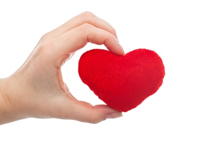 Woman holding red heart in her hand - isolated