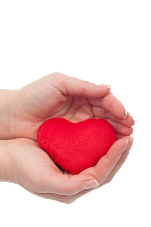 Protected red heart in the woman hands - health or love concept Stock Photo