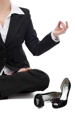 Business woman sitting in the lotus position and meditating photo