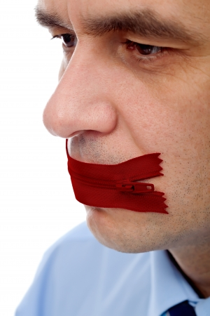 Businessman with red flies on his mouth – concept of keeping secret