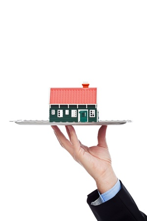 Businessman serving house - real estate concept Stock Photo