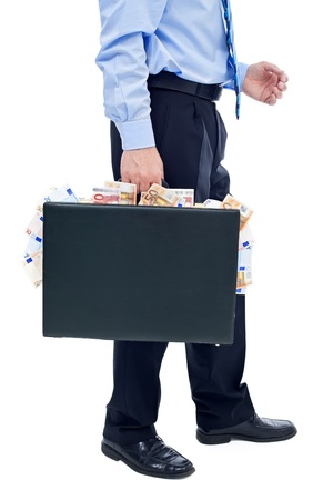 Businessman carrying briefcase overflowing with money