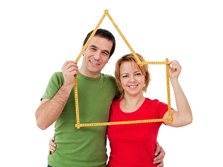 Happy couple with meter - home planning concept Stock Photo
