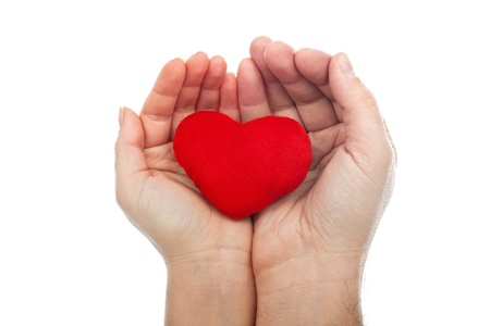 Red heart is in the couple hands