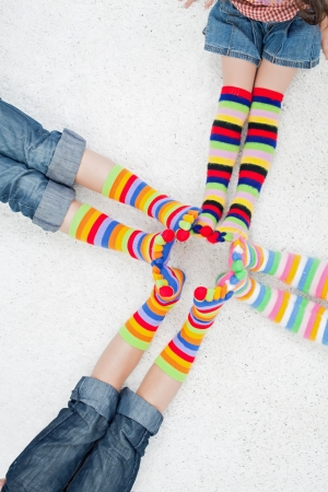 Children with long colorful socks Stock Photo