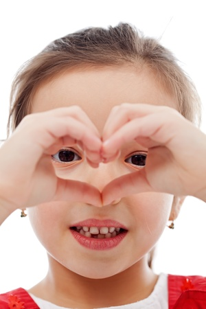 Little girl making heart shape with her hands