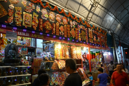 Chinese New Year is the most important festival for the Chinese.  Here, people are shopping for decoration at Chinatown (the epidentre of CNY celebration) to amp up the festive atmosphere to get ready for CNY when friends and relatives visit. Chinatown,  Stock Photo - 17436612