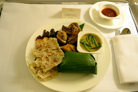 room service: Rice wrapped in banana leaves; typical traditional Indonesian dish as Room Service