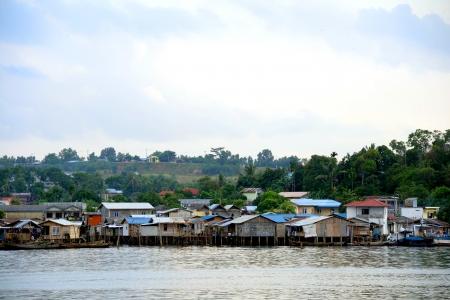 slums: Slums villages over sea at Batam, Indonesia