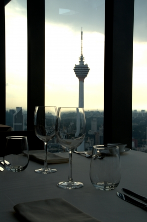 kl: Classy Fine dining restaurant at sunset in Kuala Lumpur Malaysia KL Tower in background