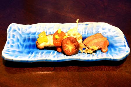 Japanese Kaiseki Grilled sea bass, braised duck breast with tomato sauce, Edamame, Sano flower, paprika, Shitake mushroom