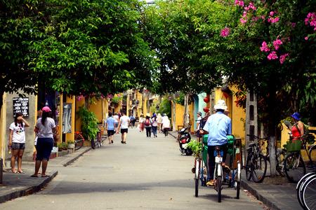 non la: Trishaw driver in Hoi An, Vietnam Editorial