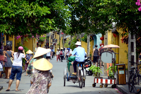 non la: Trishaw driver in Hoi An, Vietnam Editorial