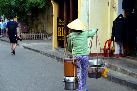 non: Vietnamese Street Hawker at Hoi An with Non La Hat