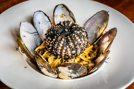 urchin: Spaghetti with Sunset Clams and Sea Urchin Stock Photo