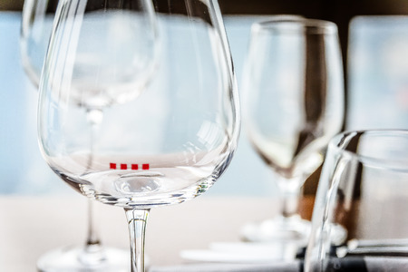 high class: glassware and china  in modern contemporary High class fine dining restaurant interior Stock Photo