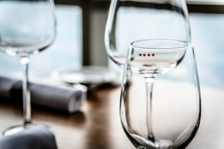 epicurean: glassware and china  in modern contemporary High class fine dining restaurant interior Stock Photo