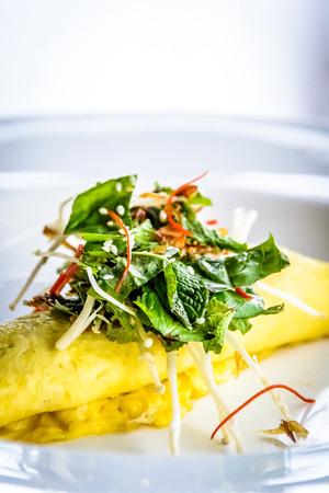 entrees: Sydney Crab Omelette, Enoki Mushroom, and Herb Salad, Miso Mustard Broth Stock Photo