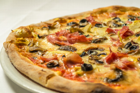 entrees: Italian pizza with olives