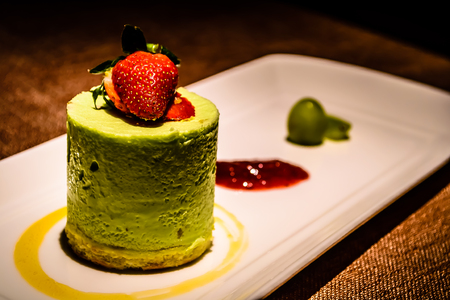 Pistachio panna cotta  italian dessert with raspberry sauce and strawberry