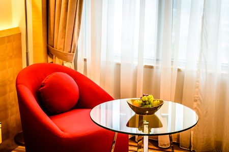 beautiful red armchair and coffee table in bedroom, condominium, hotel