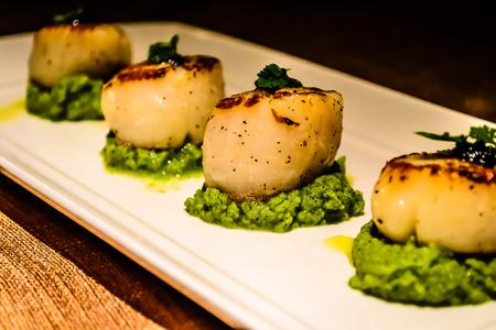 appetiser: seared scallops as appetiser in italian restaurant