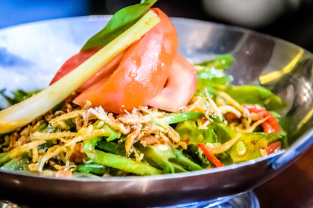Tumis Kecipir CindelarasStir-fried baby winged beansTraditional paste sauce, sliced reed chili and crispy anchovies.