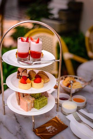 three tier afternoon tea set and pastries Stock Photo