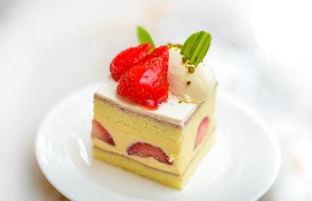 Strawberry Chiffon Entremet cake on white china plate Stock Photo