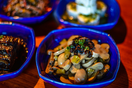 Assortment of Classic Northern China Cold Appetisers in fine-dining restaurant: button mushrooms are accentuated with Chinese truffle. Stock Photo