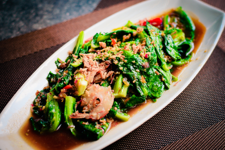thai Stir-fried fresh baby kailan with prawn, garlic and oyster sauce. Stock Photo