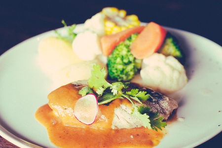 Red snapper fillet with potato, vege of the day and bell pepper sauce