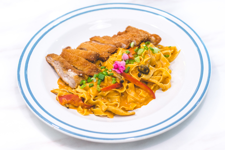 Homemade Tagliatelle with Chicken Katsu and Japanese Curry Stock Photo - 118200697