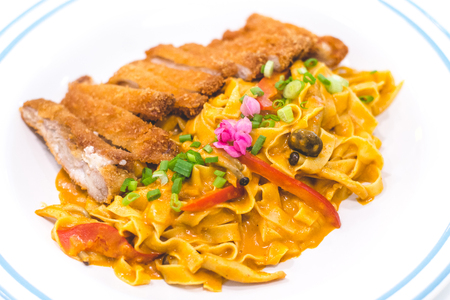 Homemade Tagliatelle with Chicken Katsu and Japanese Curry Stock Photo - 118200776