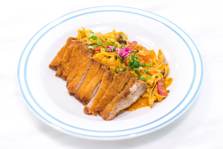 Homemade Tagliatelle with Chicken Katsu and Japanese Curry Stock Photo - 118200989
