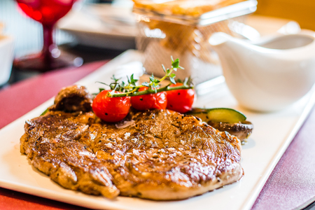 L'Entrecote de Boeuf 200 days grain fed Angus rib eye with a dense brandy cream sauce and crispy fries.