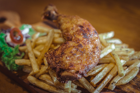Crispy Fried Chicken Drumstick with crispy french fries and vinegrette salad