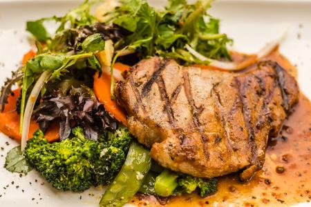 Pork Neck Fillet Steak Very tender and juicy pork collar steak served with garden veggies.  Choice of mushroom/ black pepper sauce.