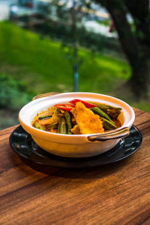 Mild fish curry with chilli, ladys fingers, okra, long beans, snap beans
