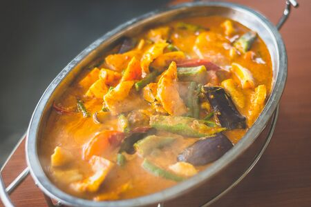 Curry Assam Fish slice with eggplant brinjal okra ladys fingers long beans snap beans
