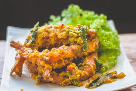 prawns stir fried in salted egg paste and basil and chilli
